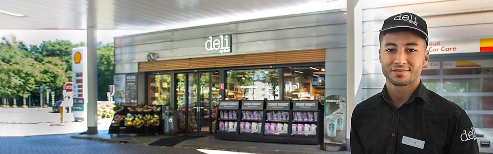 Mo standing in front of deli by Shell